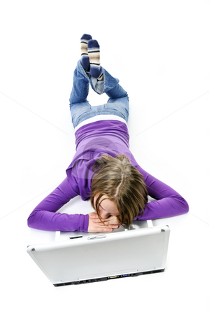 Girl with computer stock photo, Tired young girl lying down asleep on laptop computer by Elena Elisseeva
