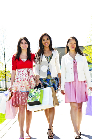 Young girlfriends shopping stock photo, Three young girl friends holding shopping bags at mall by Elena Elisseeva