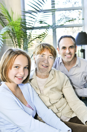 Three generations stock photo, Happy family of three generations sitting together by Elena Elisseeva