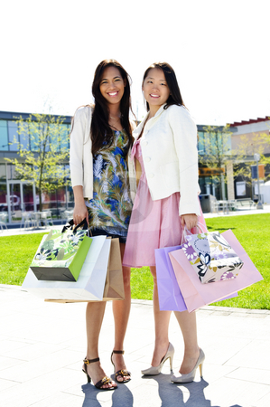 Girlfriends shopping stock photo, Two girl friends standing at outdoor mall with shopping bags by Elena Elisseeva