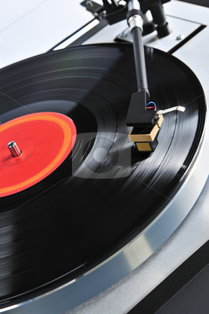 Record on turntable stock photo, Vinyl record spinning on turntable close up by Elena Elisseeva