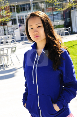 Asian woman stock photo, Young korean woman at outdoor mall in blue hoodie by Elena Elisseeva