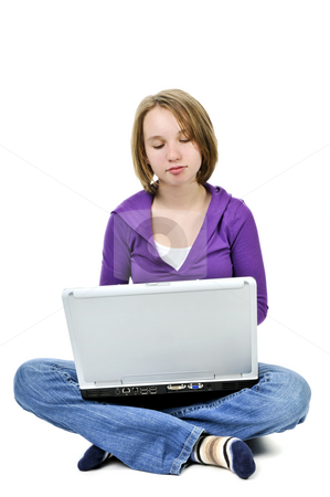 Girl with computer stock photo, Young girl sitting cross legged with laptop computer by Elena Elisseeva