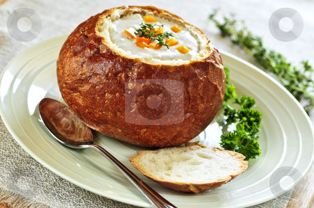 Soup in bread bowl stock photo, Lunch of soup served in baked round bread bowl by Elena Elisseeva