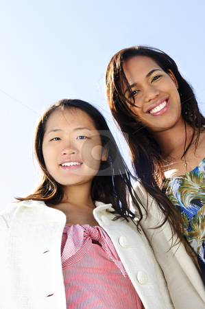 Young girl friends stock photo, Two diverse young girlfriends smiling into camera by Elena Elisseeva