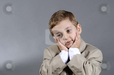 Upset boy stock photo, Portrait of upset little boy by Dragos Iliescu