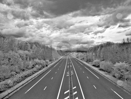 Highway to hell stock photo, Infrared picture of an empty highway with stormy clouds hdr processed by Laurent Dambies