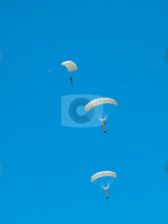 Group of parachutists stock photo, Group of parachute jumpers  against pure blue sky by Laurent Dambies