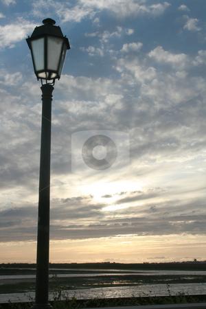 Lights stock photo, Street ligth on a  beach sun set by Marc Torrell