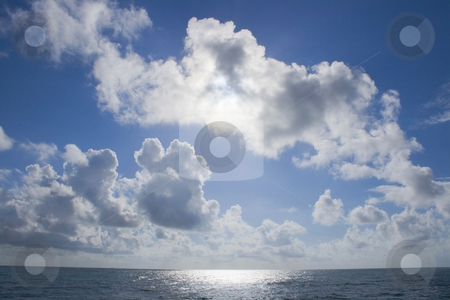 Sky stock photo, Cloudy skyand and sun water reflexion by Marc Torrell