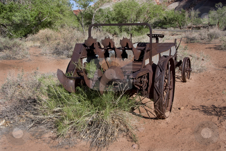 Americana stock photo, Old wagon in the desert with blue sky and green trees by Mark Smith