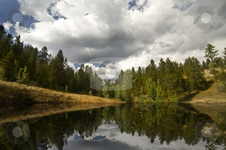 Mountain Lake stock photo, High mountain lake showing tree reflections by Mark Smith