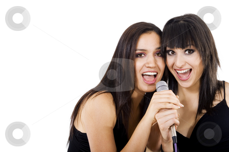 Singers stock photo, Stock photo of two girls singing, isolated on white with copy space by iodrakon