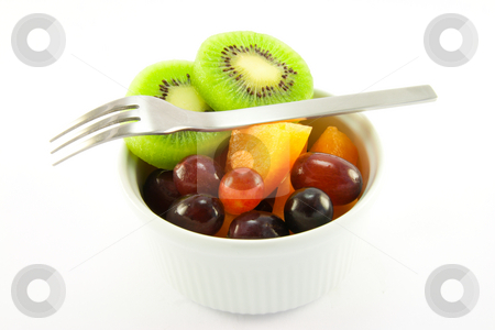 Pot of Fruit with Fork stock photo, Pot of fruit including kiwi, melon and grapeswith a  fork and clipping path on a white background by Keith Wilson
