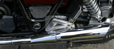 Motorcycle Exhaust stock photo, A view of a motorcycle exhaust and rear peg by Tom Weatherhead
