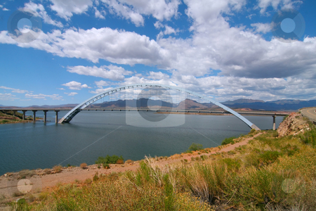 Bridge Rosvelt stock photo, Arch Bridge with blue skys and puffy clouds by Mark Smith