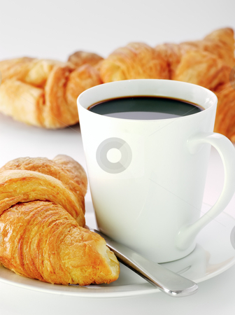 Mug and croissants stock photo, A mug of black coffee with fresh croissants by Paul Turner