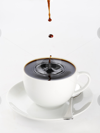 Coffee drops stock photo, A cup of black coffee full to the brim with drops splashing on the surface threatening to spill over. by Paul Turner