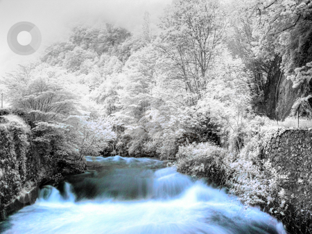Mountain stream stock photo, Slow motion powerful mountain stream in infrared hdr processed by Laurent Dambies