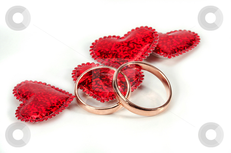 Wedding rings stock photo, Two wedding ring on a white background. by Sergey Goruppa