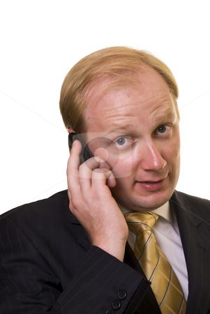 Businesman with phone stock photo, Businesman speeking on the phone on white background by Roman Kalashnikov