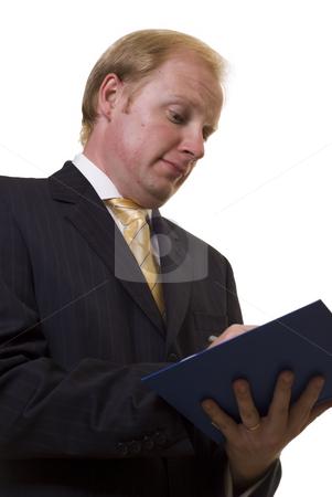 Businesman taking notes stock photo, Businesman taking notes on white background by Roman Kalashnikov