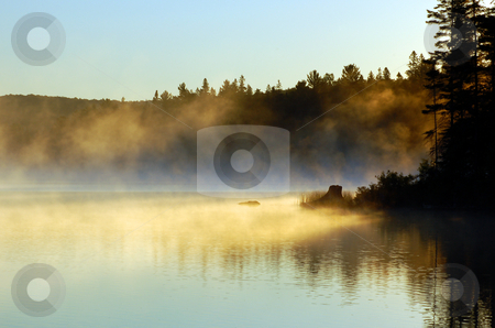 Morning stock photo, Sunrise and mist in beautiful lake in Algonquin Park by Pavel Cheiko