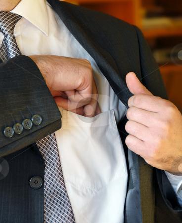Businessman hand in inner pocket stock photo, Businessman hand  in inner jacket pocket by Julija Sapic