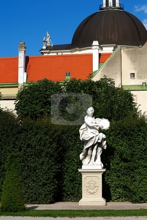 Statue of woman playing tambourine stock photo, Statue of women playing on tambourine in a garden by Juraj Kovacik