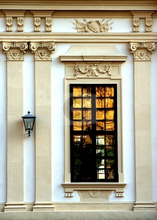 Gold window stock photo, Historical window, on facade with decorative columns by Juraj Kovacik