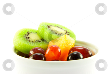 Kiwi, Melon and Grapes stock photo, Pot of kiwi, melon and grapes with clipping path on a white background by Keith Wilson