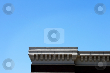 Roof Top stock photo, Rooftop of a building with blue sky in the background. by Henrik Lehnerer
