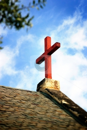 Cross Church Roof stock photo, Cross on church roof top with a blue and white sky in background. by Henrik Lehnerer