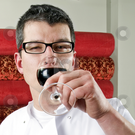 Tasting wine stock photo, A wine waiter tasting a glass of wine by Corepics VOF