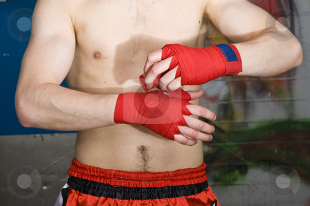 Bandaging stock photo, A muay thai fighter bandaging his hands before a fight by Corepics VOF