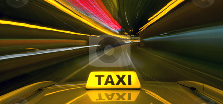 Taxi at warb speed stock photo, Taxi driving at high speed through the heavy traffic at night, seen from the roof of the cab by Corepics VOF