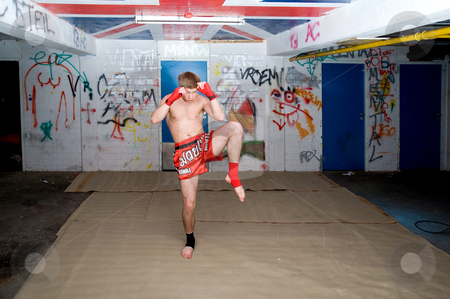 Warming Up stock photo, A Muay Thai figher warming up in a sburban basement by Corepics VOF