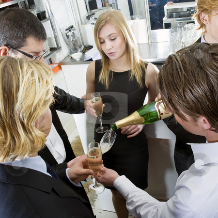 Refilling Champagne stock photo, Waiter refilling his guests glasses with champagne by Corepics VOF