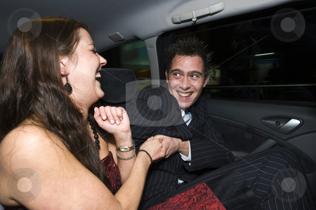 Backseat fun stock photo, A couple having fun in the backseat of a taxi after a night out by Corepics VOF