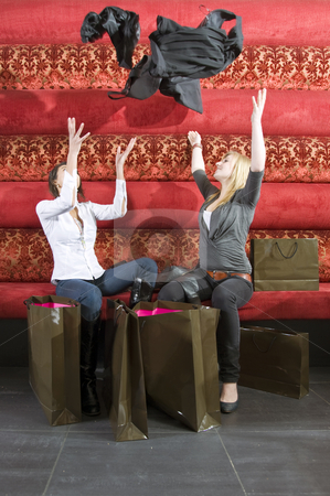 Ecstatic shoppers stock photo, Two women acting ecstatic with the purchases from their shopping spree by Corepics VOF