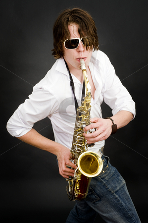 Saxophone player stock photo, A virtuoso saxophone player showing off by Corepics VOF