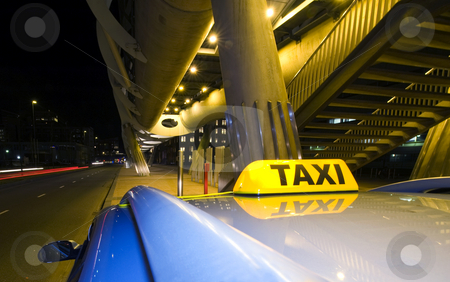 Waiting taxi stock photo, A taxi, waiting for the next fare near the exit of a futuristic public transportation station by Corepics VOF