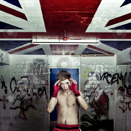 Boxer's block stock photo, A boxer practising his blocks and rapid movement of evading hits in a graffiti clad suburban basement by Corepics VOF