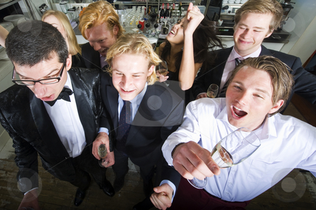 Bar celebration stock photo, Group of smartly dressed people celebrating an event in a bar by Corepics VOF