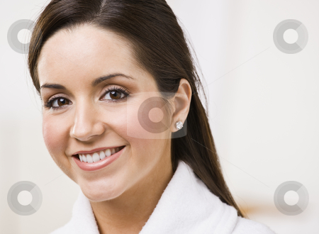 Smiling brunette woman stock photo, Attractive brunette smiling and looking at the camera. Horizontally framed shot. by Jonathan Ross