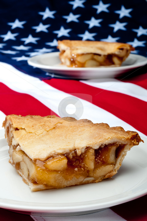 Shallow focus vertical image of 2 pcs of apple pie on the Americ stock photo, Shallow focus vertical image of 2 pcs of apple pie on the American flag by Vince Clements