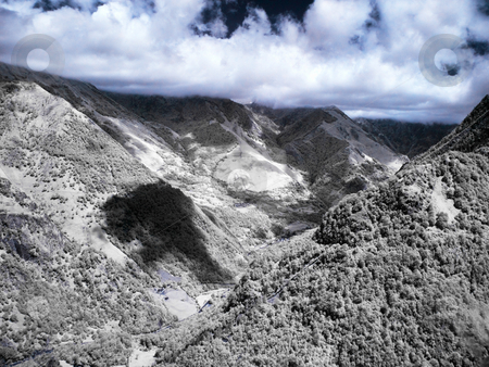 Dramatic mountain landscape stock photo, Mountain landscape in infrared view from Lescun in French pyrenees by Laurent Dambies