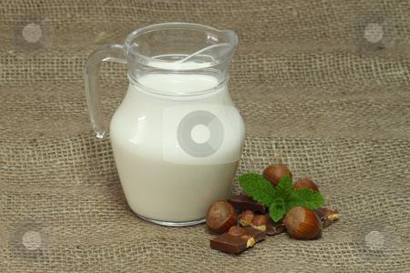 Milk jug stock photo, Milk jug on brown background by Birgit Reitz-Hofmann
