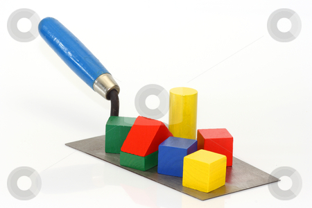 Construction stock photo, Trowel with toy bricks on bright background by Birgit Reitz-Hofmann