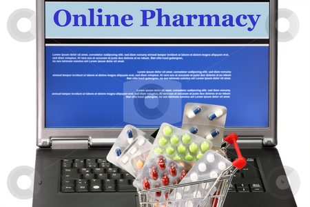 Online pharmacy stock photo, Online pharmacy- collage in laptop with trolley filled with pills by Birgit Reitz-Hofmann
